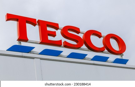MACCLESFIELD,UK - NOVEMBER 12 2014: Tesco supermarket sign with logo.  Retail food prices are falling with all supermarkets including Tesco cutting their prices.