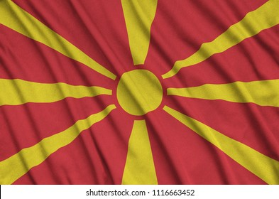 Macedonia flag  is depicted on a sports cloth fabric with many folds. Sport team banner