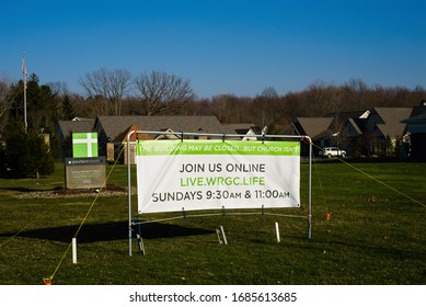 MACEDONIA, OH, USA - MARCH 25, 2020: A church banner advertises online services during closure of in-person assemblies due to Coronavirus precautions.