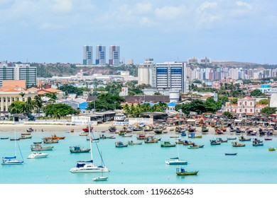 Maceio, Alagoas, Brazil - December 08, 2014:View of fishing boats and yacth in the harbour in Maceio, Alagoas, Brazil