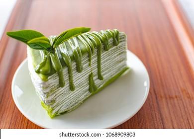 macha green tea crepe cake on plate