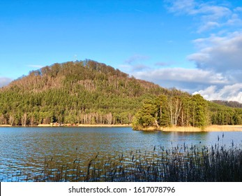 Macha lake sunny day view of duck island and borne hill - Shutterstock ID 1617078796