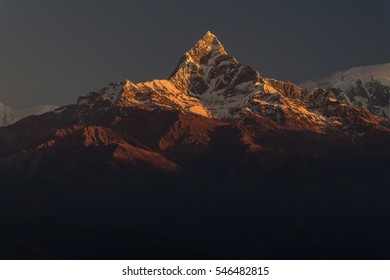 Machapuchare (6993m) seen at sunrise from Sarangkot in Pokhara. The mountains is regarded a holy one by local people. It is believed to belong to the Hindu god Shiva. Nepal.