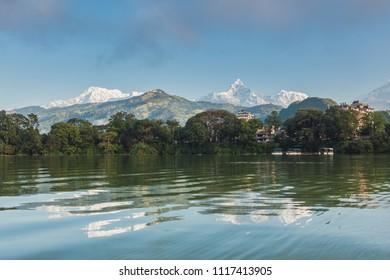 The Machapuchare and Annapurna range seen from Phewa Lake in Pokhara, Nepal