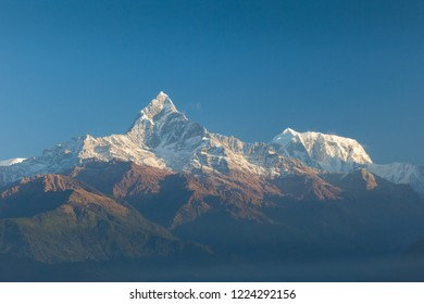 Machapuchare (Fish Tail) and Annapurna Range mountains in the Himalayas, Nepal
