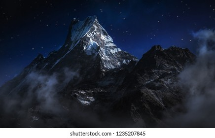 Machapuchare at night. A mountain in the Annapurna Himalayas of north central Nepal. Digital editing image