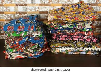 MACHILIPATANAM, ANDHRA PRADESH, INDIA, MARCH 23, 2019: Machilipatnam (Pedana) style of Kalamkari dress materials with beautiful  block printed designs on display in a textile shop.