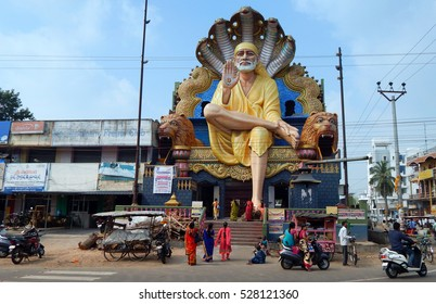 MACHILIPATNAM,INDIA-NOVEMBER 30:54 feet high Shiridi SaiBaba statue in temple resting foot on tortoise meaning protection  on November 30,2016 in Machilipatnam,India