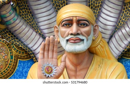 MACHILIPATNAM,INDIA-NOVEMBER 30:Closeup portrait of 54 feet high Shiridi SaiBaba statue in under hood of five headed snake  on November 30,2016 in Machilipatnam,India