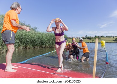 MACHILLY, FRANCE - JULY 6, 2014: Unidentified athlete participates in the swimming race of the Lake Machilly Triathlon which is part of the TriSaleve of Annemasse organization.