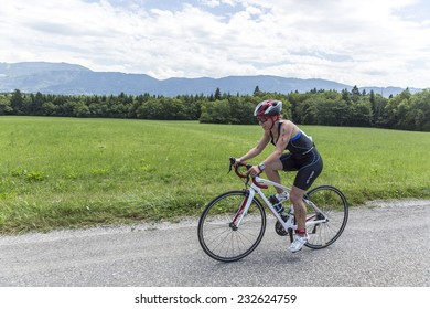 MACHILLY, FRANCE -JULY 6, 2014: Unidentified athlete participates in the cycling race of the Lake Machilly Triathlon which is part of the TriSaleve of Annemasse organization.