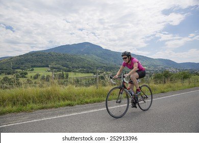 MACHILLY, FRANCE JULY 6, 2014: Unidentified athlete participates in the cycling race of the Lake Machilly Triathlon which is part of the TriSaleve of Annemasse organization.