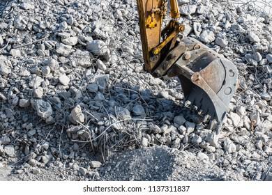 Machine for building demolition. Rubble pile on the construction site.