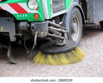 machine cleaning dust from sidewalk