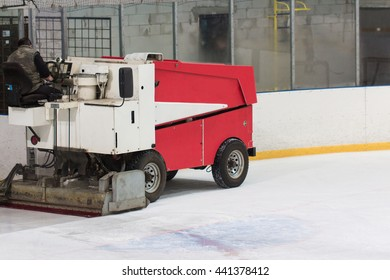 machine cleans the ice skating rink