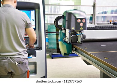 Machine for cutting, grinding and laser marking of flat glass and worker