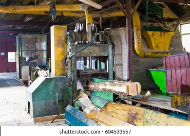 The machine for cutting tree trunks into planks at the small sawmill
