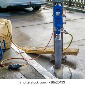 Machine for drilling cores. Use in concrete on a filling station site