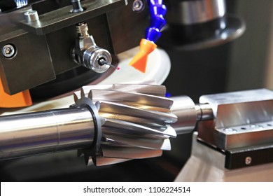 Machine for gear grinding and quality control