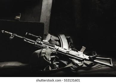 machine gun AK, military helmet and ammunitions