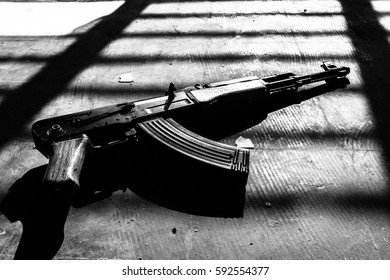 Machine gun with a black and white image.