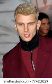 "Machine Gun Kelly attends the Netflix ""Bright"" premiere on Dec. 13, 2017 at the Regency Village Theatre in Los Angeles, CA."