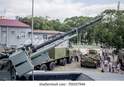Machine gun on modern military battleship. Modern russian military cars on background. Russia, Vladivostok.