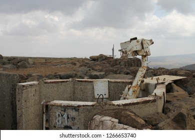 Machine gun position and pillbox against Syrian grey winter sky on Mount Bental Israeli military outpost on the border - disused bunker in the Golan Heights