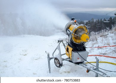 Machine gun for the production of artificial snow in the winter mountains, prepare for ski activities