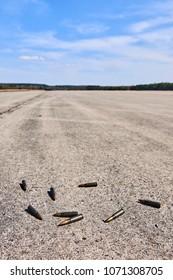 Machine gun shells lying on a abandoned military airport