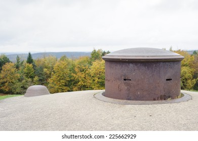 A machine gun turret on Ford Douaumont, Verdun. Woods beyond now cover the open battlefield of 1916 with its thousands of shell-holes and trenches.