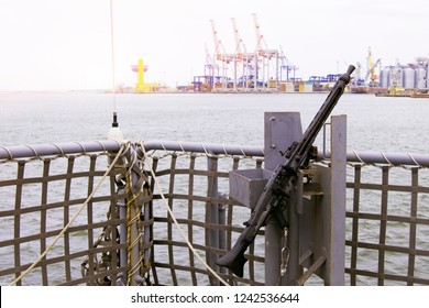 A machine gun of a warship against the backdrop of the sea and cost. The concept of the navy and defense.
