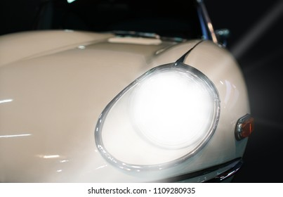 machine industry, white car headlight close-up