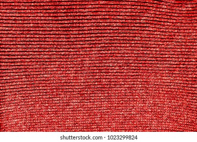 Machine knitted fabric. red pattern close up texture
