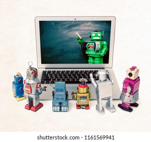 Machine learning concept with retro robots at a laptop computer isolated  E= mc