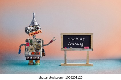 Machine learning concept. Robot creative design toy metal funnel hopper, cogs wheels gears metallic body. Black chalkboard classroom interior, futuristic colors background.