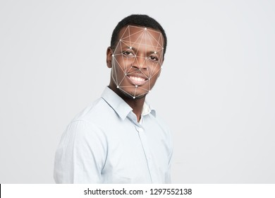 Machine learning systems technology , accurate facial recognition biometric technology and artificial intelligence concept. African man face and dots connect on face.