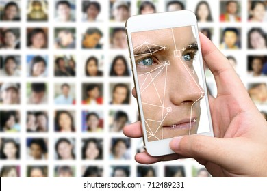 Machine learning systems technology , accurate facial recognition biometric technology and artificial intelligence concept. Hand using mobile phone and Man face and dots connect on face.