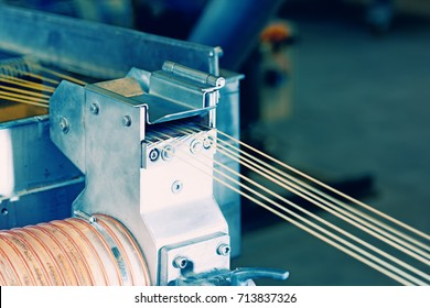 Machine with lines of synthetic fibers
