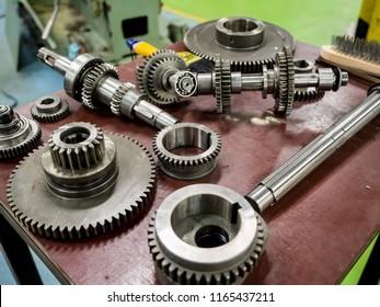 Machine maintenance in machine shop.