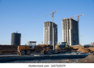 Сonstruction machine Motor Grader and bulldozer at a construction site level the ground and gravel stones for the construction of a new asphalt road. Road construction equipment.