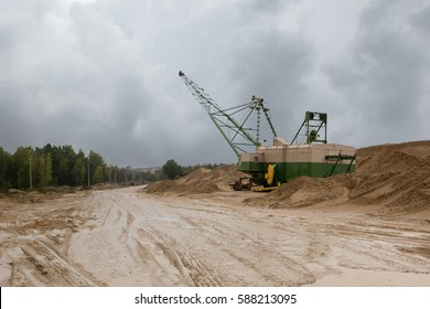 machine on the sand quarry on a rainy day