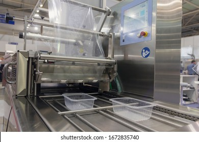 Machine for packing food products close-up. Industry