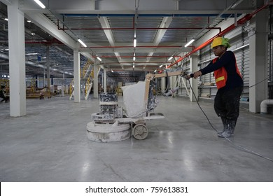 Machine polishing surface floor concrete for epoxy and hardener work