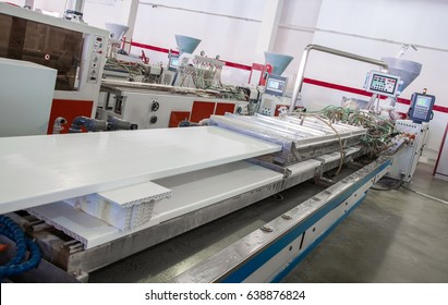 the machine produces a window sill from pvc. workshop for the production of PVC profile