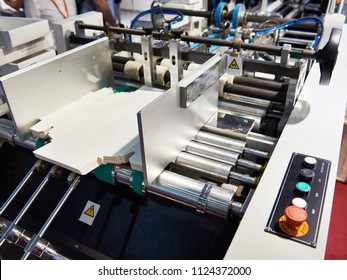 Machine for the production of cardboard packaging boxes
