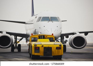 Machine for push back of the aircraft to taxiway.