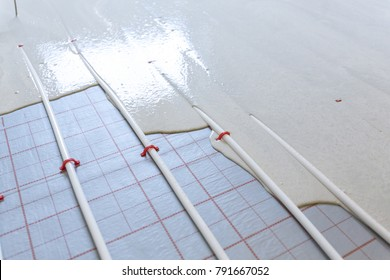 Machine running screed flooring. Worker at a construction site screed floor.