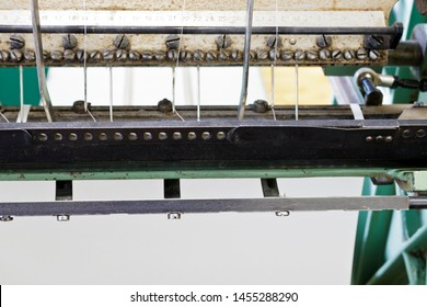 Machine for stitching book pages. The elements of the machine for stitching book pages with threads in typography.