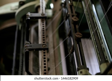 Machine for stitching book pages with threads in typography. Machine for sewing books and notebooks with threads.